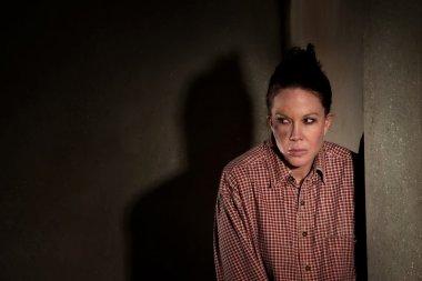 Frightened woman in hallway
