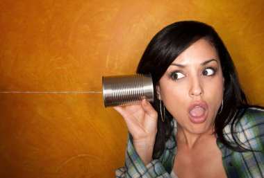 Hispanic woman with tin can telephone