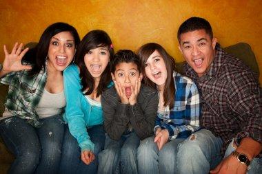 Hispanic Family with Big Reaction