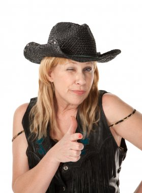 Winking western woman making a pistol with her hand
