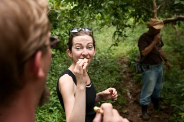 Trying natural food with a guide in Costa Rica