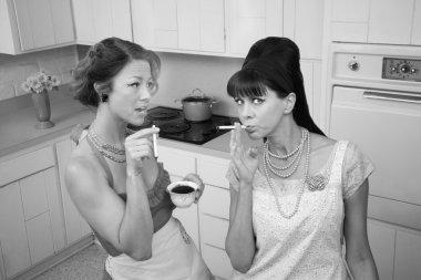 Women Smoking Cigarettes