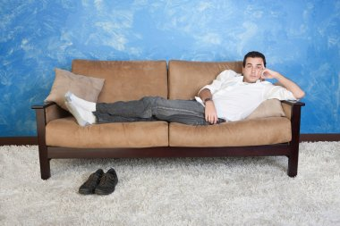 Man Relaxes on Sofa