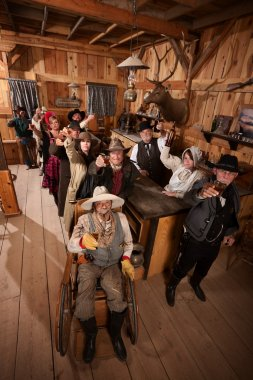 Customers in Old Saloon Toasting Drinks