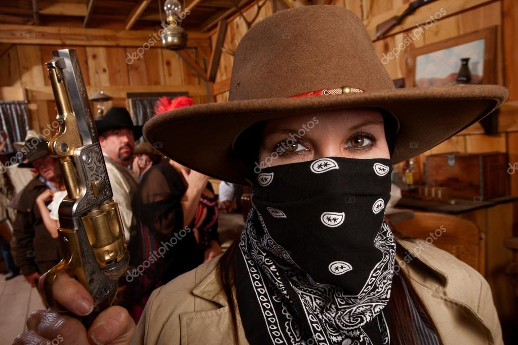 A Woman Covering Her Face With Bandana Holds Gun In Saloon Photo By Creatista