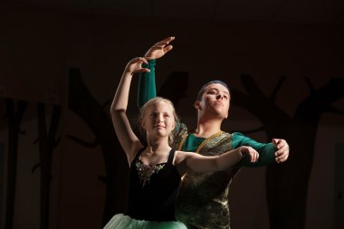 Dance Student Practices with Teacher