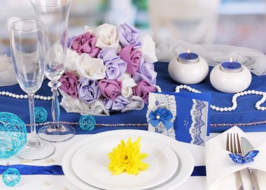 Serving fabulous wedding table in purple and blue color of the restaurant b