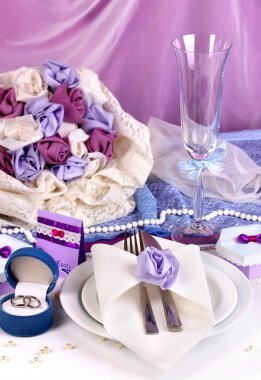 Serving fabulous wedding table in purple color on white and purple fabric b