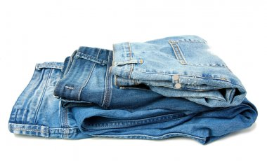 Several fashion blue jeans isolated on white