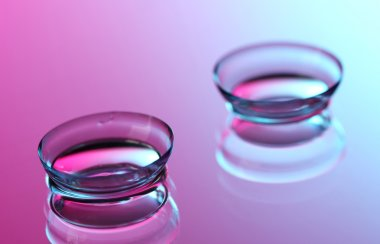 contact lenses, on pink-blue background