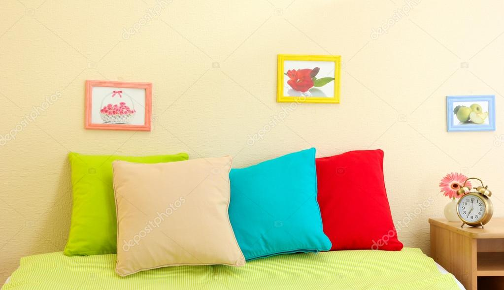 Empty Bed With Pillows And Sheets In Bedroom Stock Photo