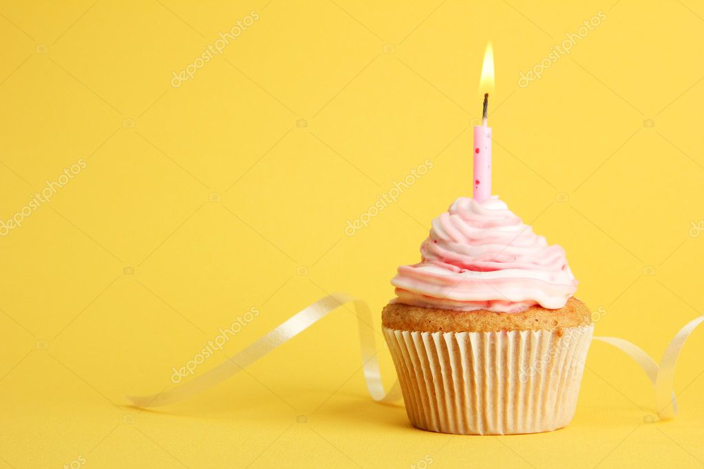 Tasty Birthday Cupcake With Candle On Yellow Background Stock