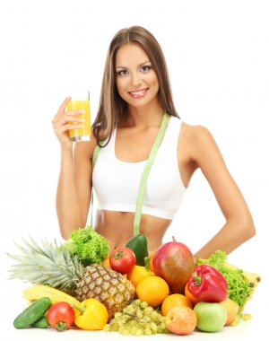 beautiful young woman with fruits and vegetables and glass of juice, isolat
