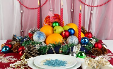 Serving Christmas table on white fabric background