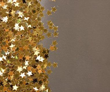 stars confetti on gray background