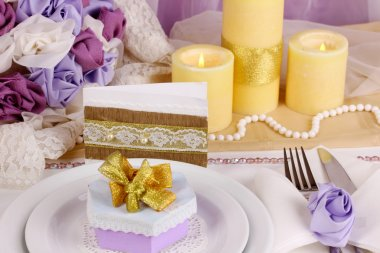 Serving fabulous wedding table in purple and gold color on white and purple fabric background
