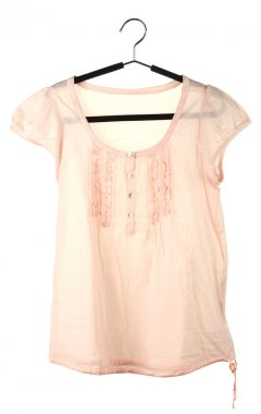 woman's pink blouse on a hanger isolated on white