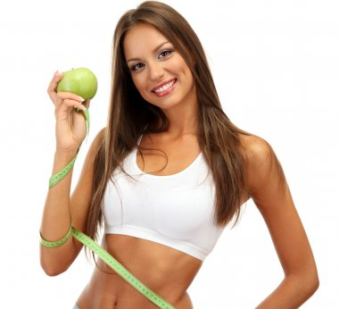 beautiful young woman with green apple and measure tape, isolated on white