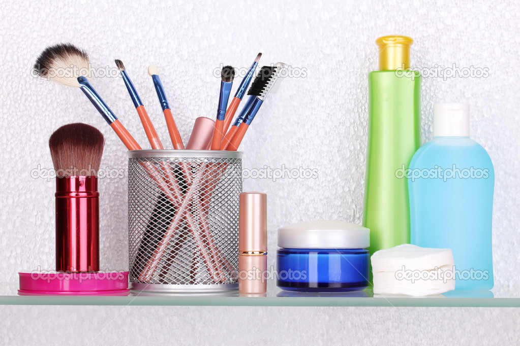 Bathroom Toiletries shelf with cosmetics and toiletries in bathroom — stock photo