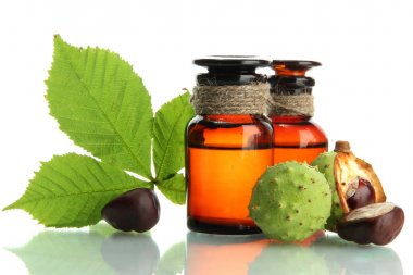 medicine bottles with chestnuts and leaves, isolated on white