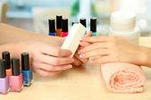 Photo Manicure process in beauty salon, close up