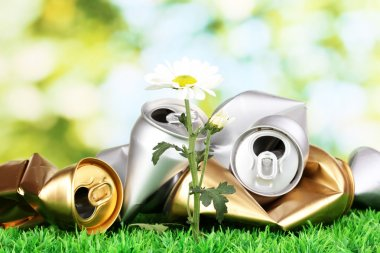 Garbage with growing flower. Environmental conservation concept