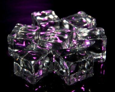 Ice cubes on dark purple background
