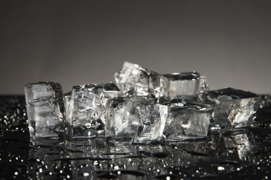 Ice cubes isolated on black