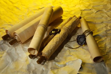 Old scrolls, on brown paper background