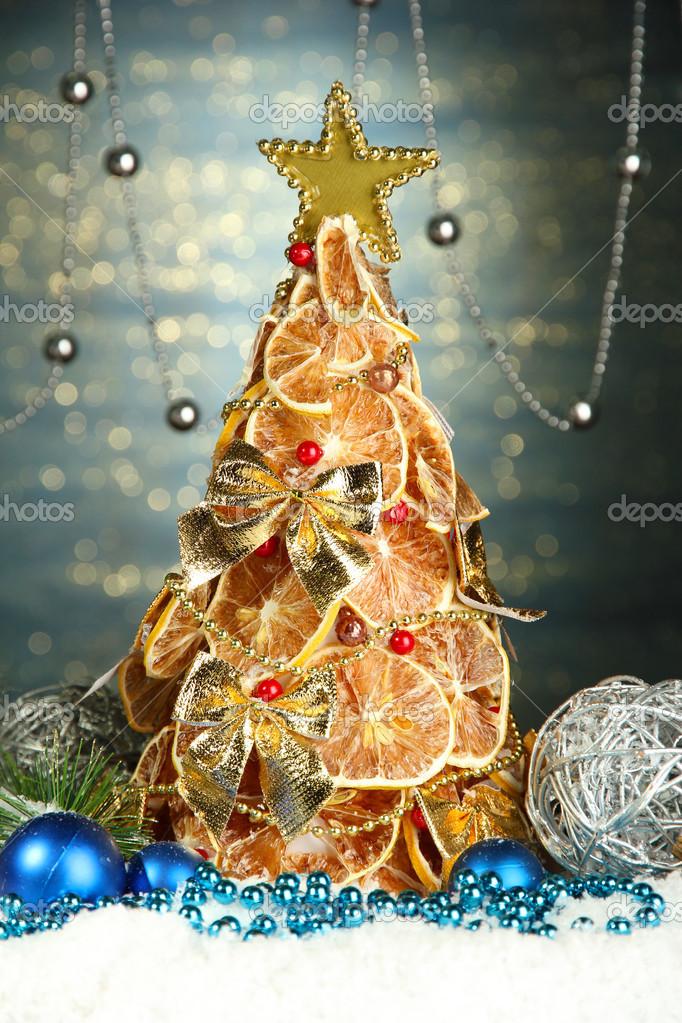 Beautiful Christmas Tree Of Dry Lemons With Decor On Shine Blue