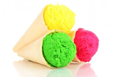 Three scoops of lemon, strawberry and kiwi ice cream in the waffle cones isolated on white