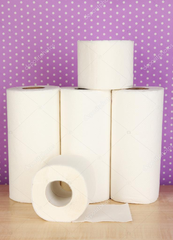 Rolls Of Toilet Paper On Purple With Dots Background Stock Photo 18597929