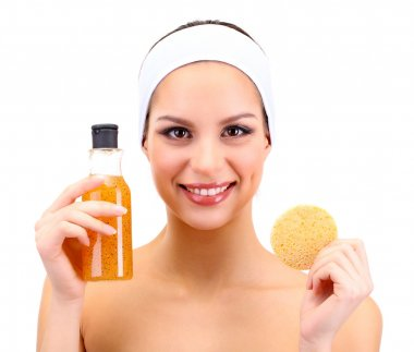Young woman cleansing her face with scrub, isolated on white