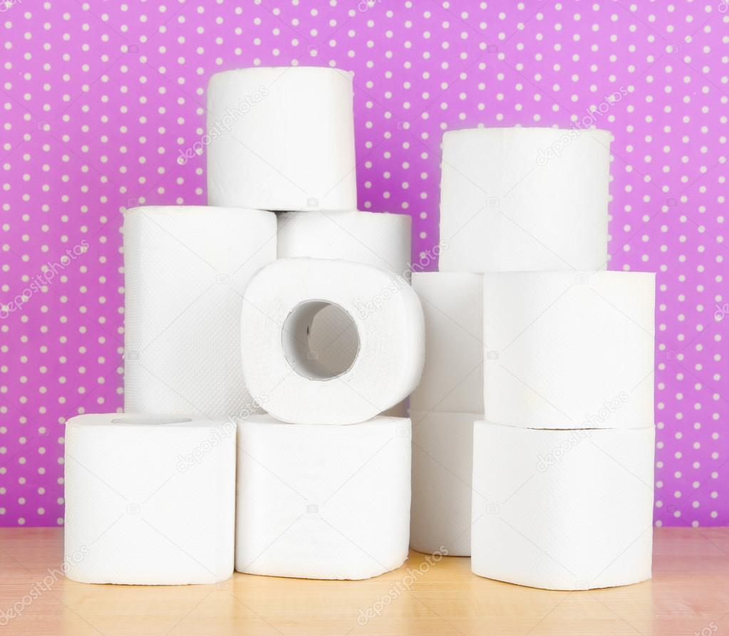 Rolls Of Toilet Paper On Purple With Dots Background Stock Photo 20192157