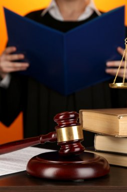 Judge read verdict on orange background