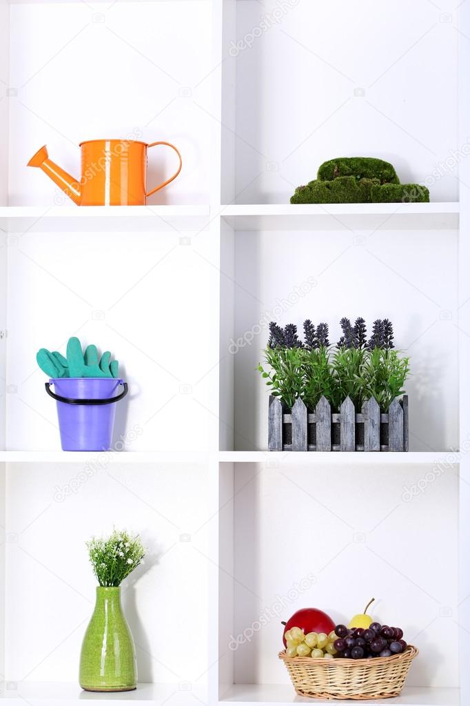 Beautiful white shelves with different gardening related objects stock photo belchonock - Beautiful photoshelves ...