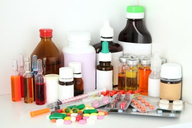 Medical bottles and pills on shelf