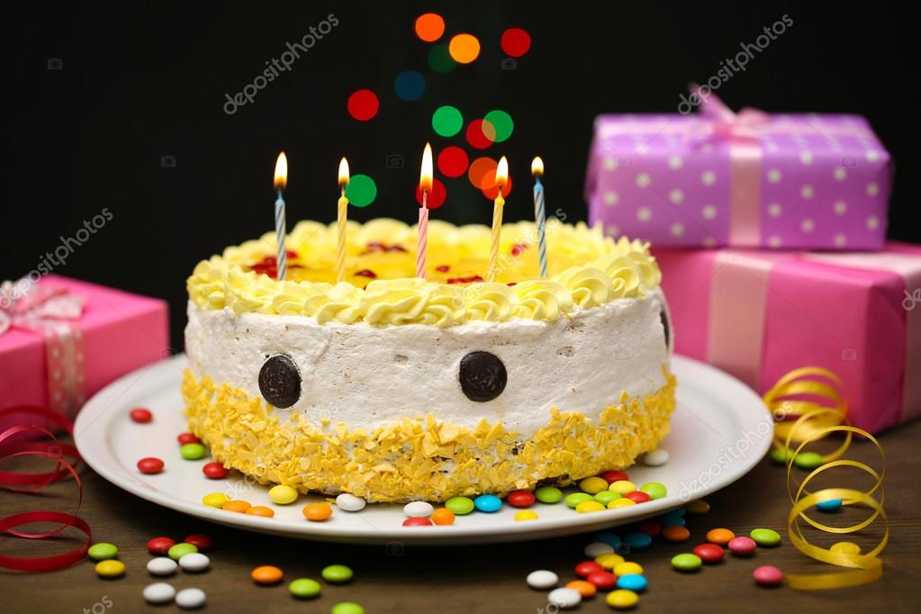 Happy Birthday Cake And Gifts On Black Background Stock Photo