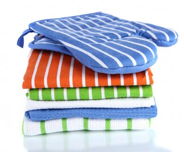 Kitchen towels of different colors and blue tacking isolated on white
