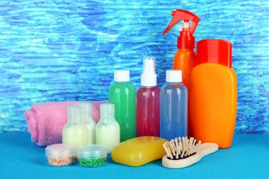 Hotel cosmetics kit on bright color background
