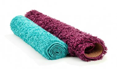 Two rolled carpets isolated on white