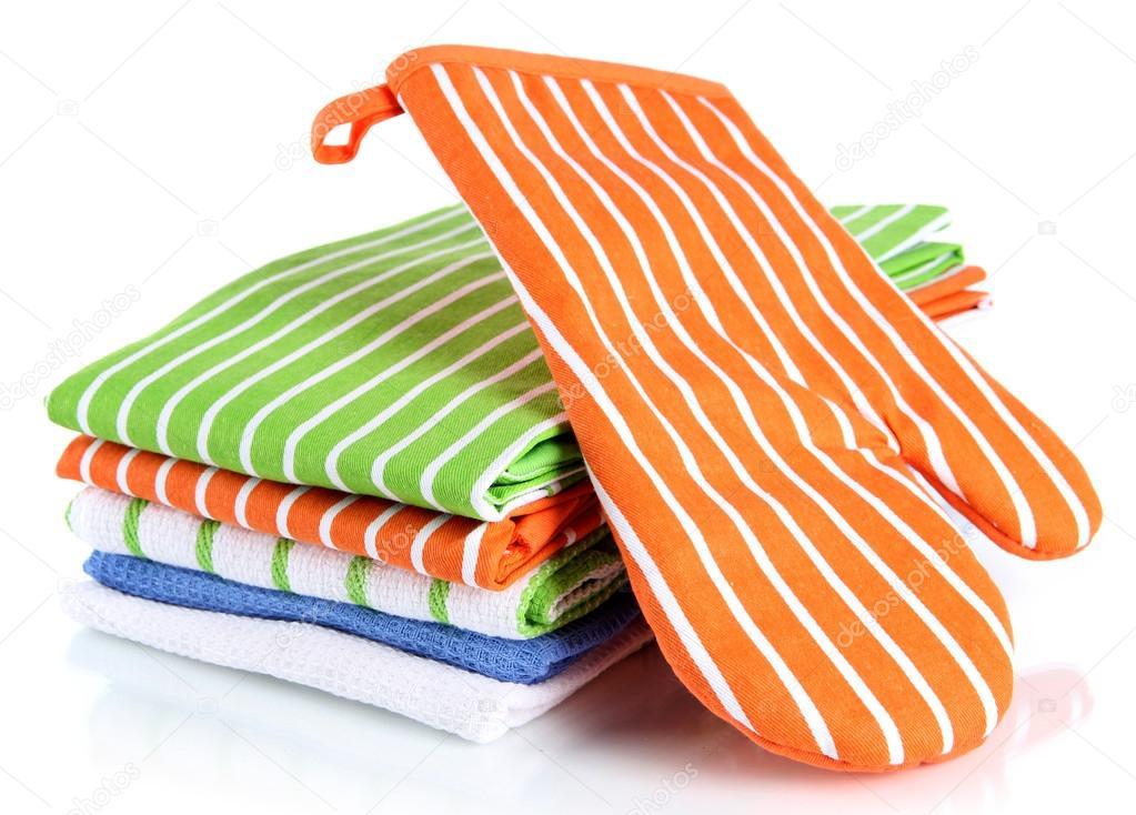 Orange Potholder And Stack Of Kitchen Towels Isolated On White Stock Photo