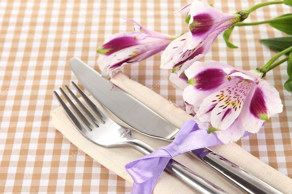 table setting background. festive dining table setting with flowers on checkered background \u2014 stock photo #22914920 m