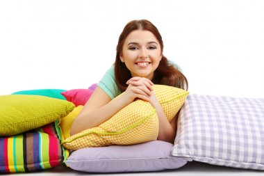 Beautiful young girl with pillows