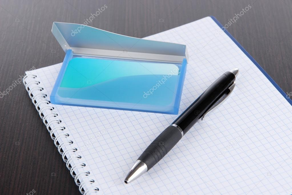 Blue business card holder notebook and pen close up stock photo blue business card holder notebook and pen close up photo by belchonock colourmoves Gallery