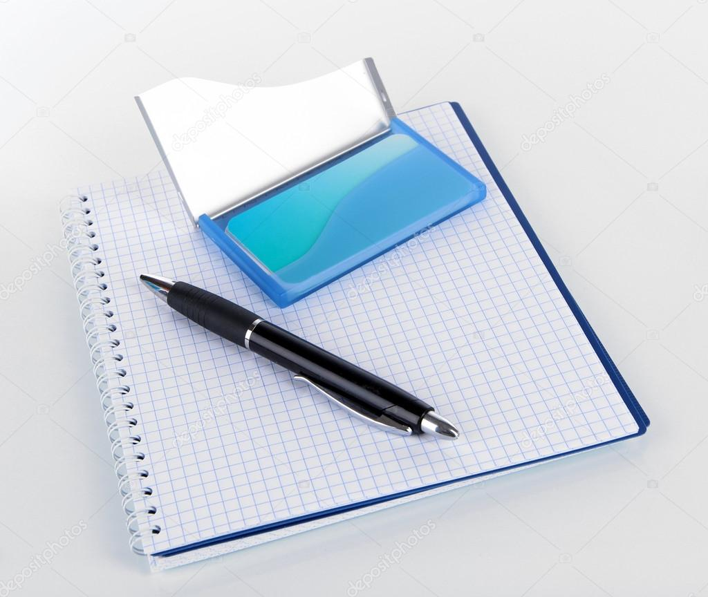 Blue business card holder, notebook and pen isolated on white ...