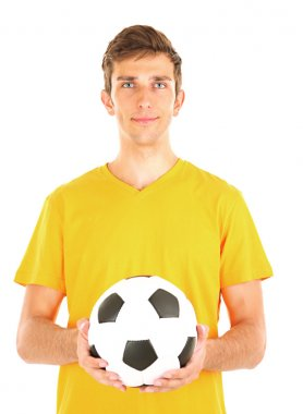 Young soccer player holding ball, isolated on white