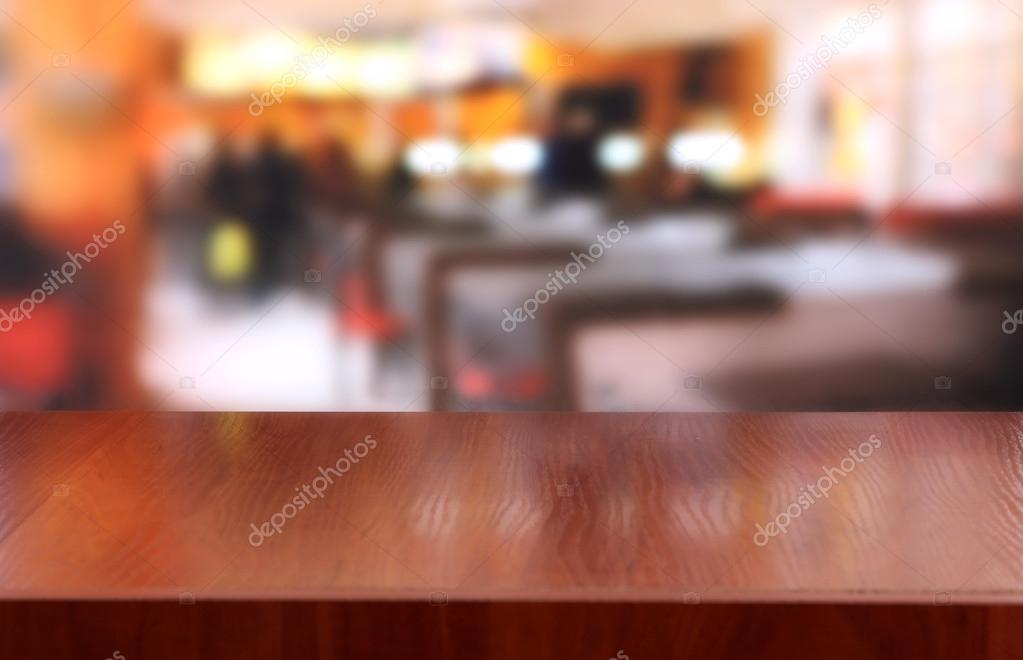 Wooden table on cafe background