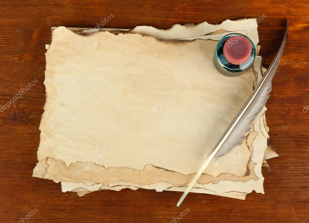 Old Paper Ink And Feather On Wooden Background Stock