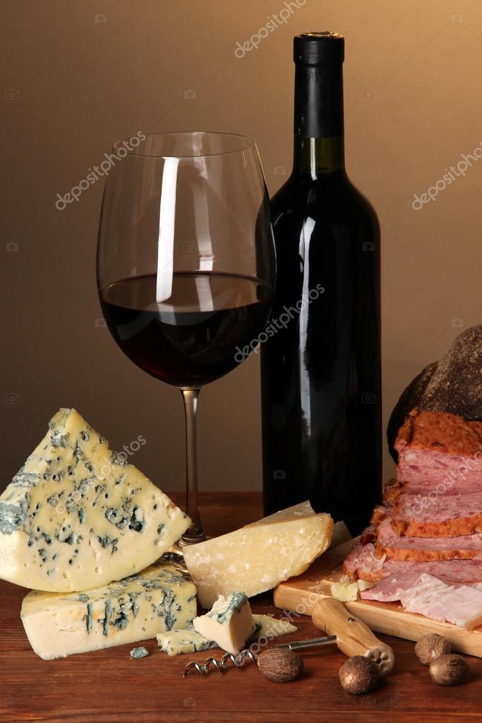 Exquisite still life of wine, cheese and meat products  Stock Photo  #26601377